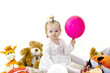 The child, a little girl playing with soft toys, education and development of children, carefree childhood