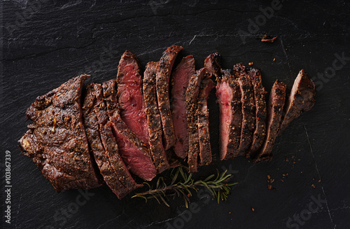 Poster grilled flat iron steak shot in flat lay style from overhead