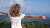 Motivational Uplifting Success Woman With Arms Raised at Top