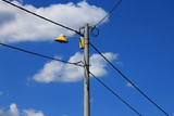 Electricity post,street lighting and cloudy sky