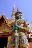 Bangkok, Thailand - December 20, 2006:  A giant guardian demon Yak with green face stands guard at Wat Phra Kaeo in the Royal Palace compound