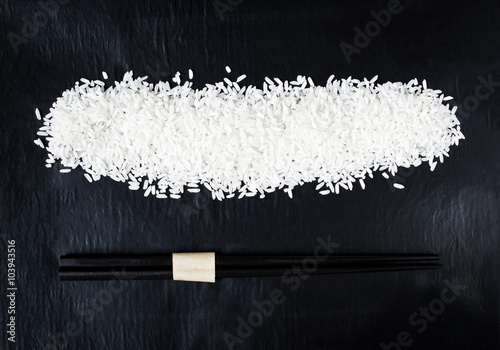 Rice with chopsticks for background Poster