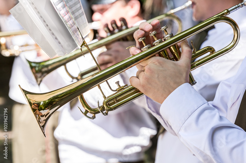 obraz lub plakat military musicians playing gold trumpets on music festival