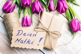 Mother's Day card and a bouquet of beautiful tulips on wooden background, with Polish words