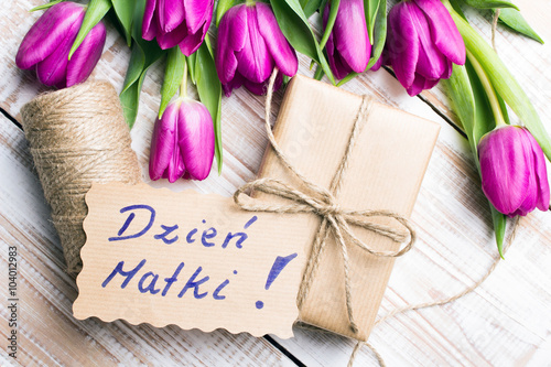 Zdjęcia na płótnie, fototapety, obrazy : Mother's Day card and a bouquet of beautiful tulips on wooden background, with Polish words