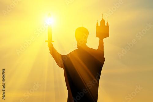Foto op Canvas Bedehuis Silhouette of monument to Nicholas Wonderworker at sunset. Kalin