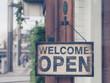 Wood open sign board hang on shop wood door