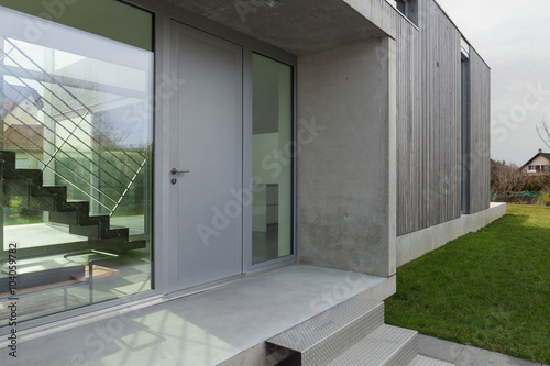 Entrance of a modern house - 104059782