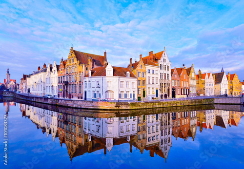 Aluminium Brugge Traditional architecture in Bruges town, reflected in water at sunrise