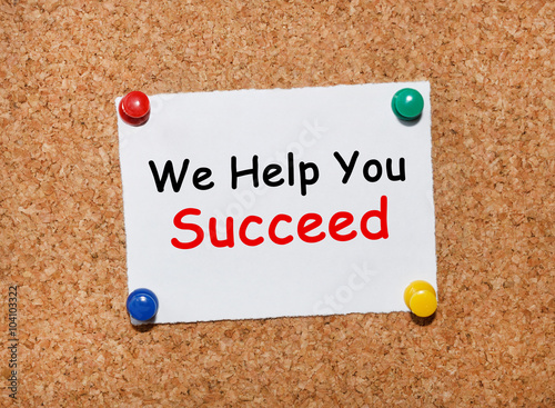 Poster The phrase We Help You Succeed typed on a white piece of note paper and pinned t