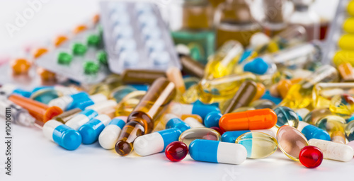 Medications tablets and capsules in a beaker Plakat