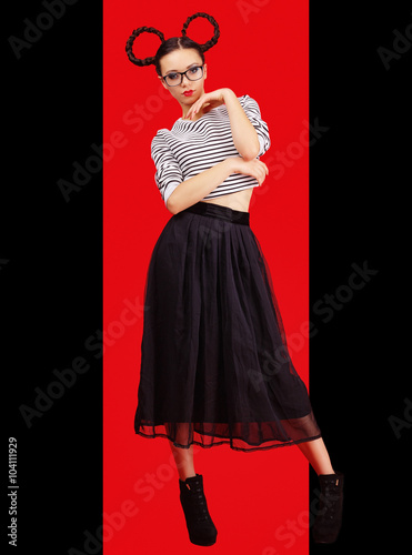 High fashion girl in the glasses with unusual hairstyle like Minnie Mouse in the Poster