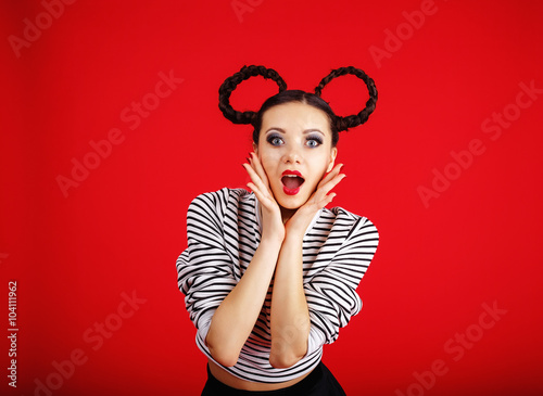 High fashion girl with unusual hairstyle like Minnie Mouse in the studio Poster