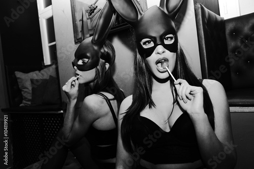 Party Girls wearing rabbit mask - 104119921