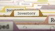 Постер, плакат: Folder in Colored Catalog Marked as Inventory Closeup View Selective Focus 3D Render