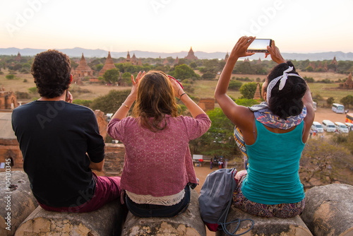 Tourists looking at sunset in Ancient Temples  at Bagan, Myanmar Poster
