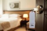 Entering hotel room - 104135791