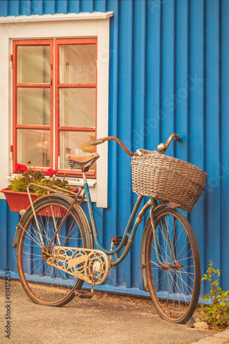 Fototapeta Old rusty lady bicycle in front of a Swedish house