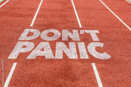 Poster Don't Panic written on running track