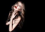 long hair. beautiful sexy girl blond model with red lips and hair. posing on a black background
