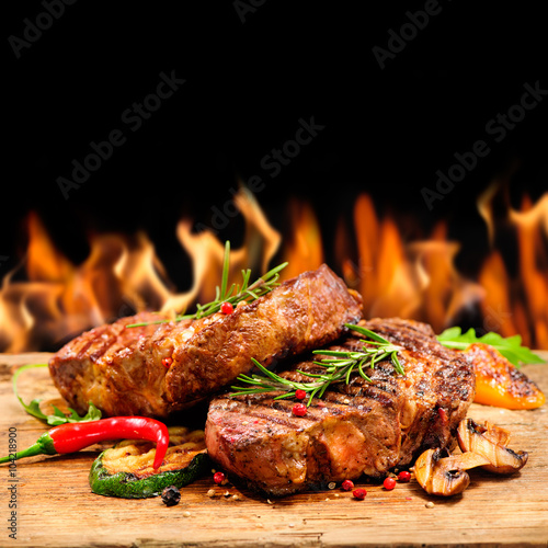 Fototapeta Grilled beef steak with flames