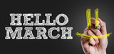 Hand writing the text: Hello March