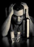 Desperate man drinking alone