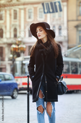 Poster Outdoor  portrait of a young beautiful woman walking at the street