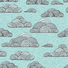Abstract vector seamless gentle pattern with clouds. Colorful stylized hand drawn cloudy sky texture on light background