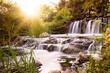 Rushing waterfall at sunset - 104331326