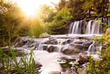 Rushing waterfall at sunset