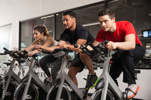 Poster People doing some spinning at a gym