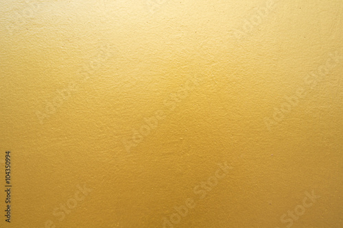 Canvas Betonbehang Gold concrete wall on background texture.