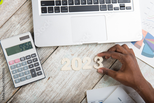 Poster Hand arranging financial year 2023