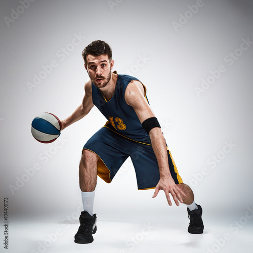 Full length portrait of a basketball player with ball Poster