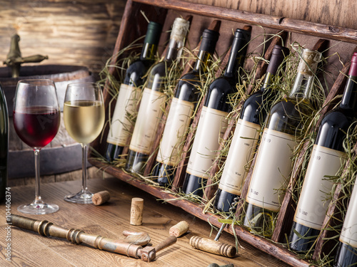 Wine bottles on the wooden shelf. плакат