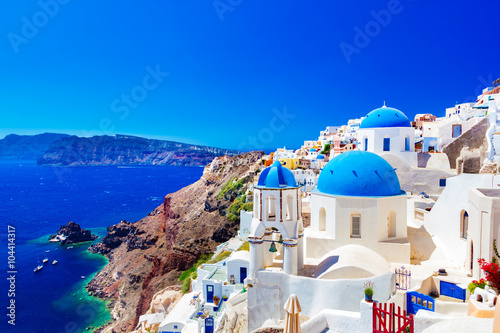 Oia town on Santorini island, Greece. Caldera on Aegean sea. Plakat