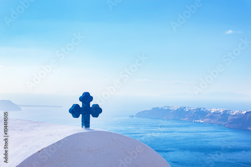 Zdjęcia na płótnie, fototapety, obrazy : Blue cross on the church roof in Fira on Santorini island, Greece. Aegean sea. view