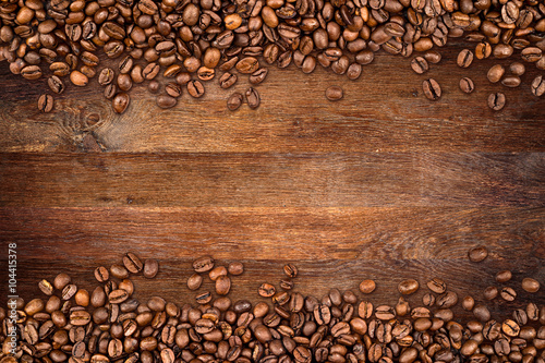 coffee background with beans on rustic old oak wood - 104415378