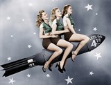 Three women sitting on a rocket   - 104427191