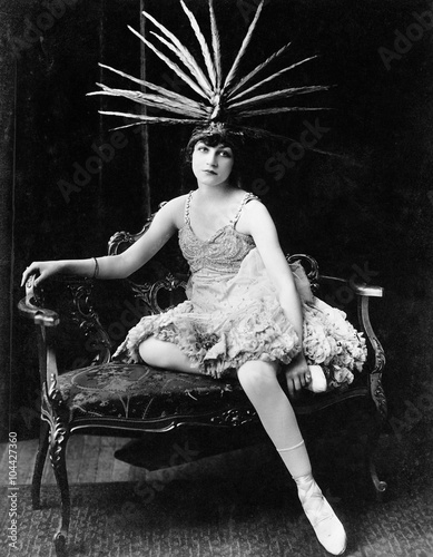 Portrait of female dancer with feather headdress  - 104427360