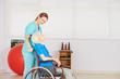 Leinwanddruck Bild Krankenpflegerin schiebt alte Frau im Rollstuhl