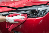 Car detailing series : Worker cleaning red car - 104428555
