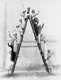 Group of women on tall ladder  - 104430594