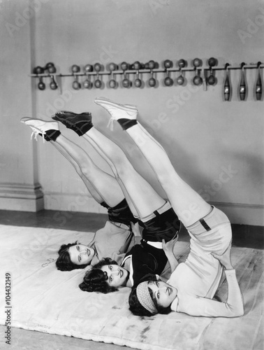 Three women exercising  - 104432149