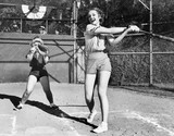 Two women playing baseball  - 104433984