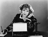 Woman at typewriter on telephone  - 104435193
