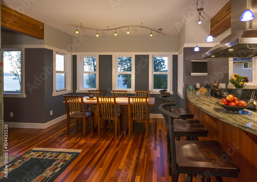 Kitchen breakfast bar and dining area table and chairs with wood floors, granite Poster