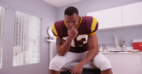 College football player waiting in doctor