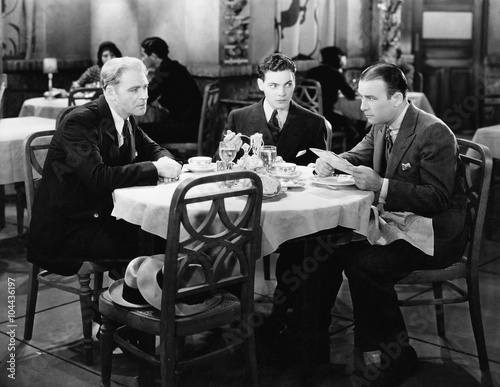 Businessmen meeting in restaurant  - 104436197
